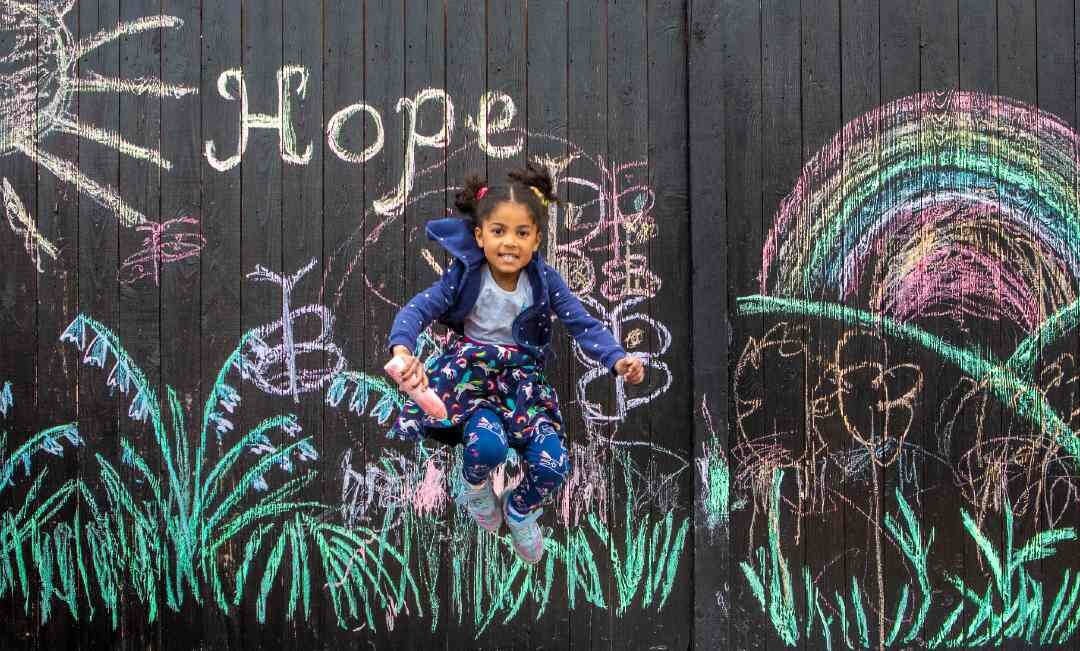 5-Year-Old Draws Messages of Hope on Garage During Lockdown