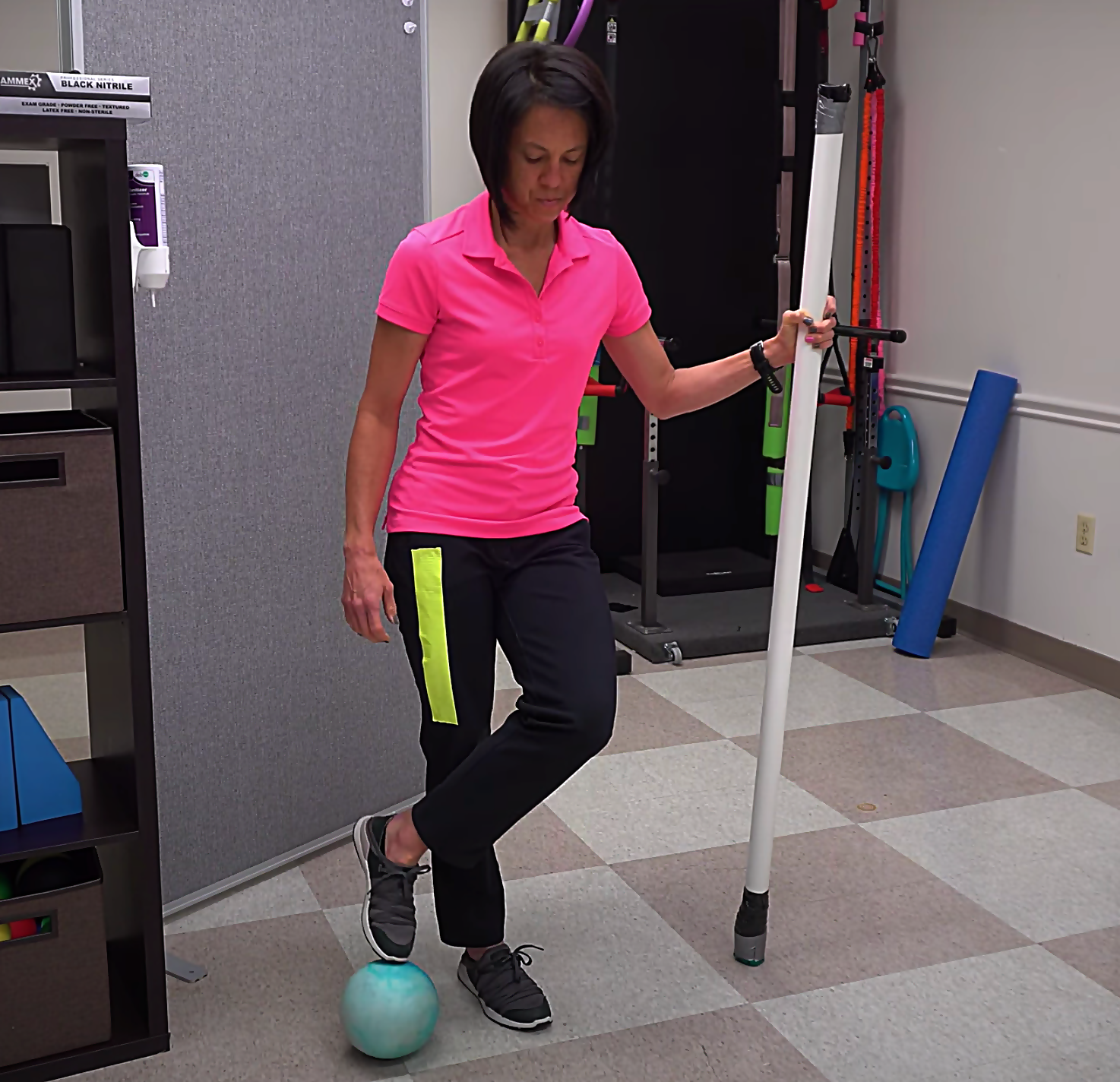 advanced balance activity with a medicine ball and half moon pattern