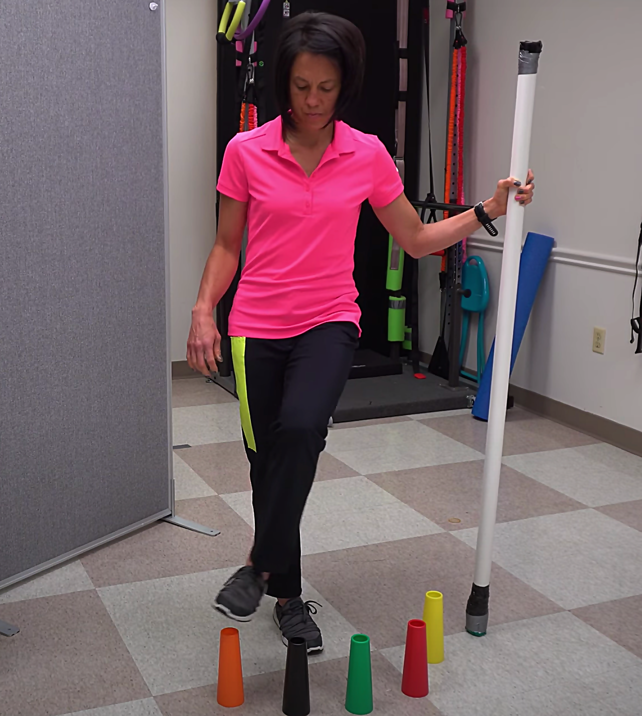 advanced walking exercise with stacking cones and crossing midline