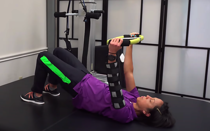 bridging exercise with alternative position for arm blocking