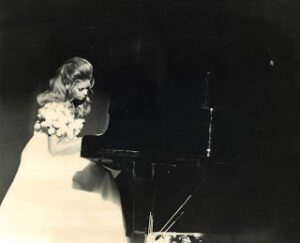 Younger Jane Little Botkin wearing a gown in a pageant (black and white)