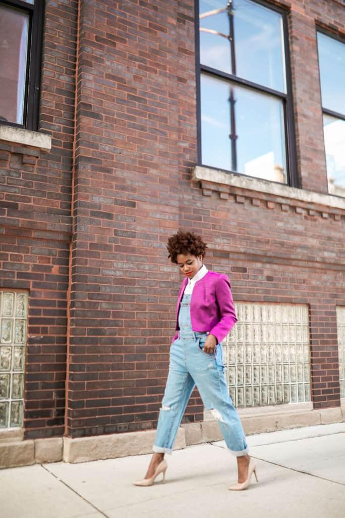 Denim overalls and purple blazer