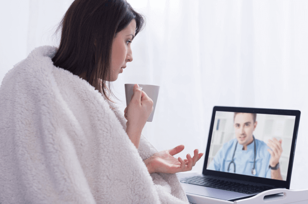 A sick patient discussing her symptoms with her doctor via a laptop, an example of telehealth growth.