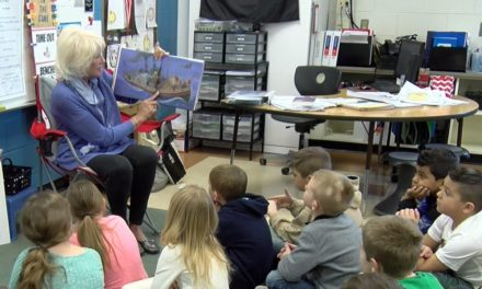 Ann Murphy reads to Michigamme students