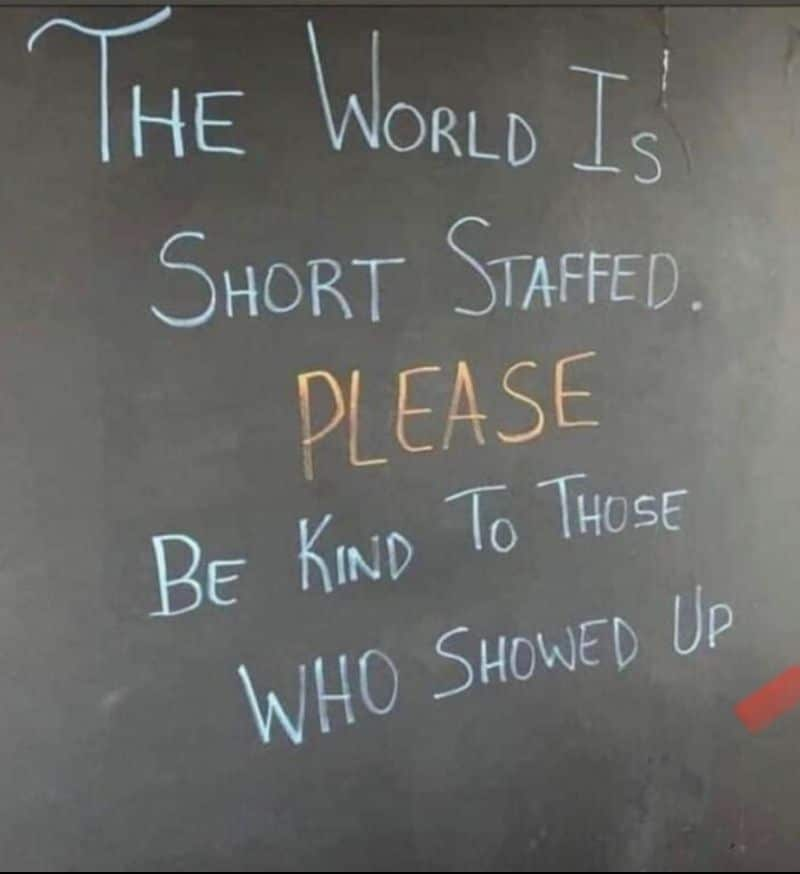 """A chalkboard sign saying """"the world is short staffed. PLEASE be kind to those who showed up."""