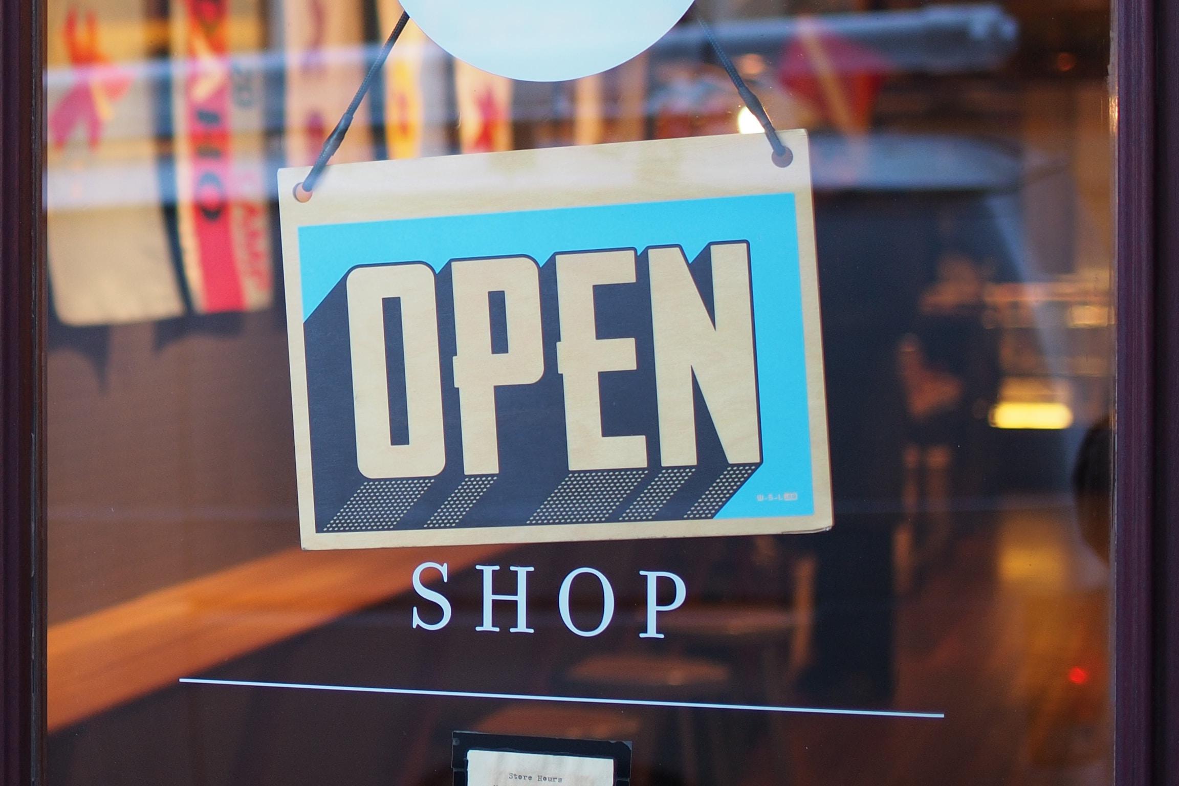 An open sign in a shop window