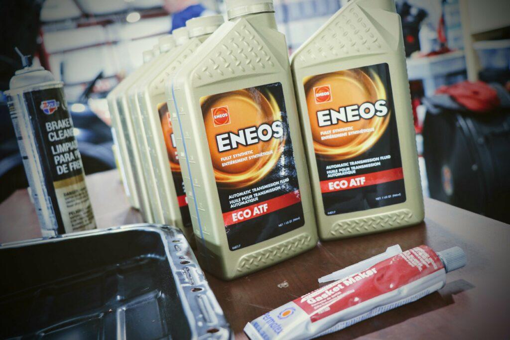 synthetic oil bottle on automotive shop workbench