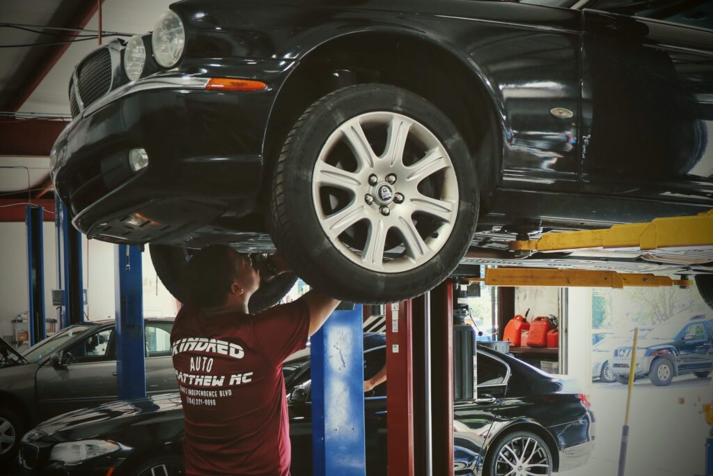 kindred automotive employee working on car that is in for service