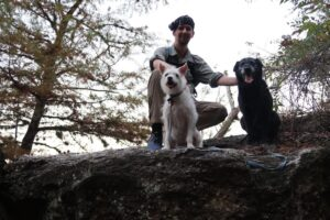 Angela, BeeGee, and Jack posing on a huge rock on the Blinn River Trail