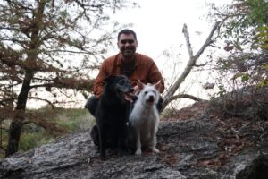 Angela, BeeGee, and Jarrett posing on a huge rock on the Blinn River Trail