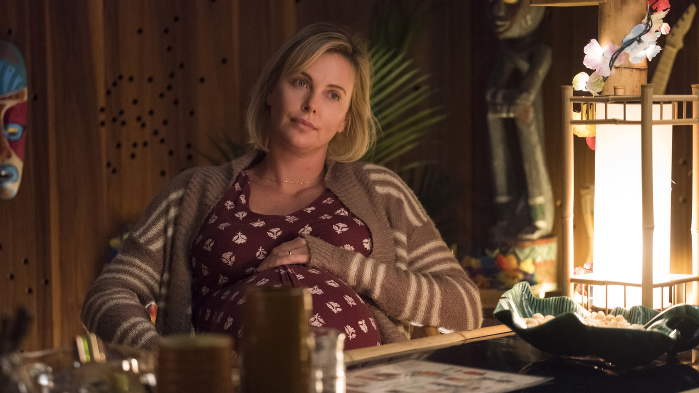 """Theron says she loved the script for <em>Tully </em>because it felt like an """"honest conversation"""" about parenting."""