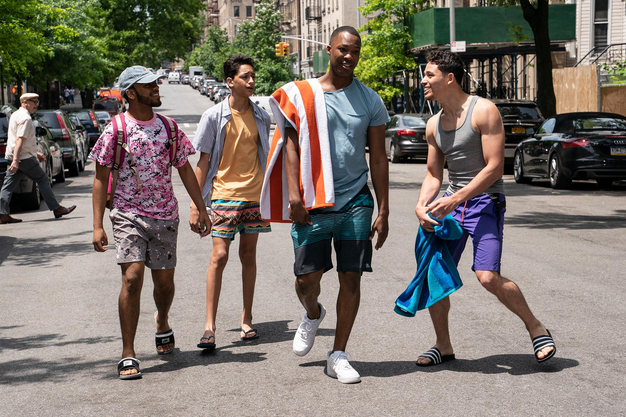 """IN THE HEIGHTS  Copyright: © 2021 Warner Bros. Entertainment Inc. All Rights Reserved.  Photo Credit: Macall Polay  Caption: (L -r) NOAH CATALA as Graffiti Pete, GREGORY DIAZ IV as Sonny, COREY HAWKINS as Benny and ANTHONY RAMOS as Usnavi in Warner Bros. Pictures' """"IN THE HEIGHTS,"""" a Warner Bros. Pictures release."""