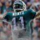 Back shot of Carson Wentz in an Eagles uniform with his arms stretched out, celebrating a touchdown.