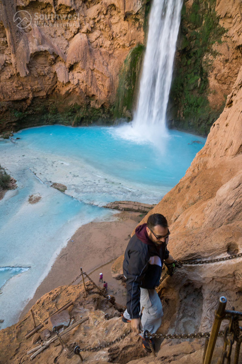 The hike down to Mooney Falls via cut steps in the rock.