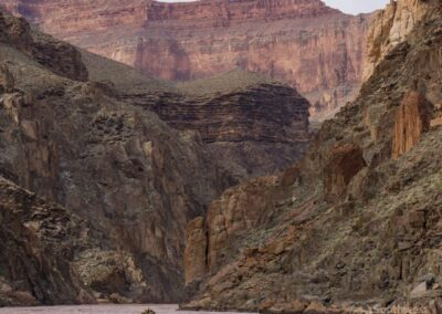 Big views of a rafter and the Grand Canyon walls.