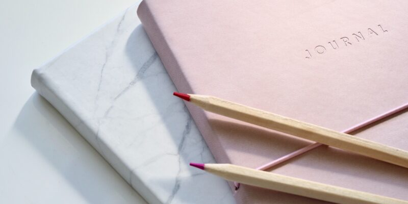 Ann Peck Journal Entry image of journal and pencils