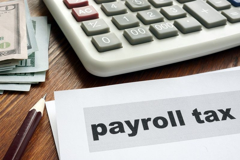 Payroll tax concept. Papers calculator and money cm