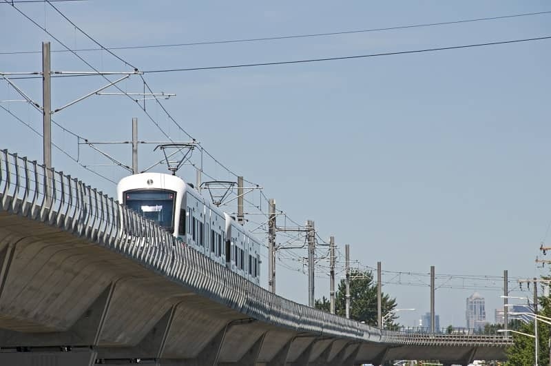 Light rail train northbound on raised track cm