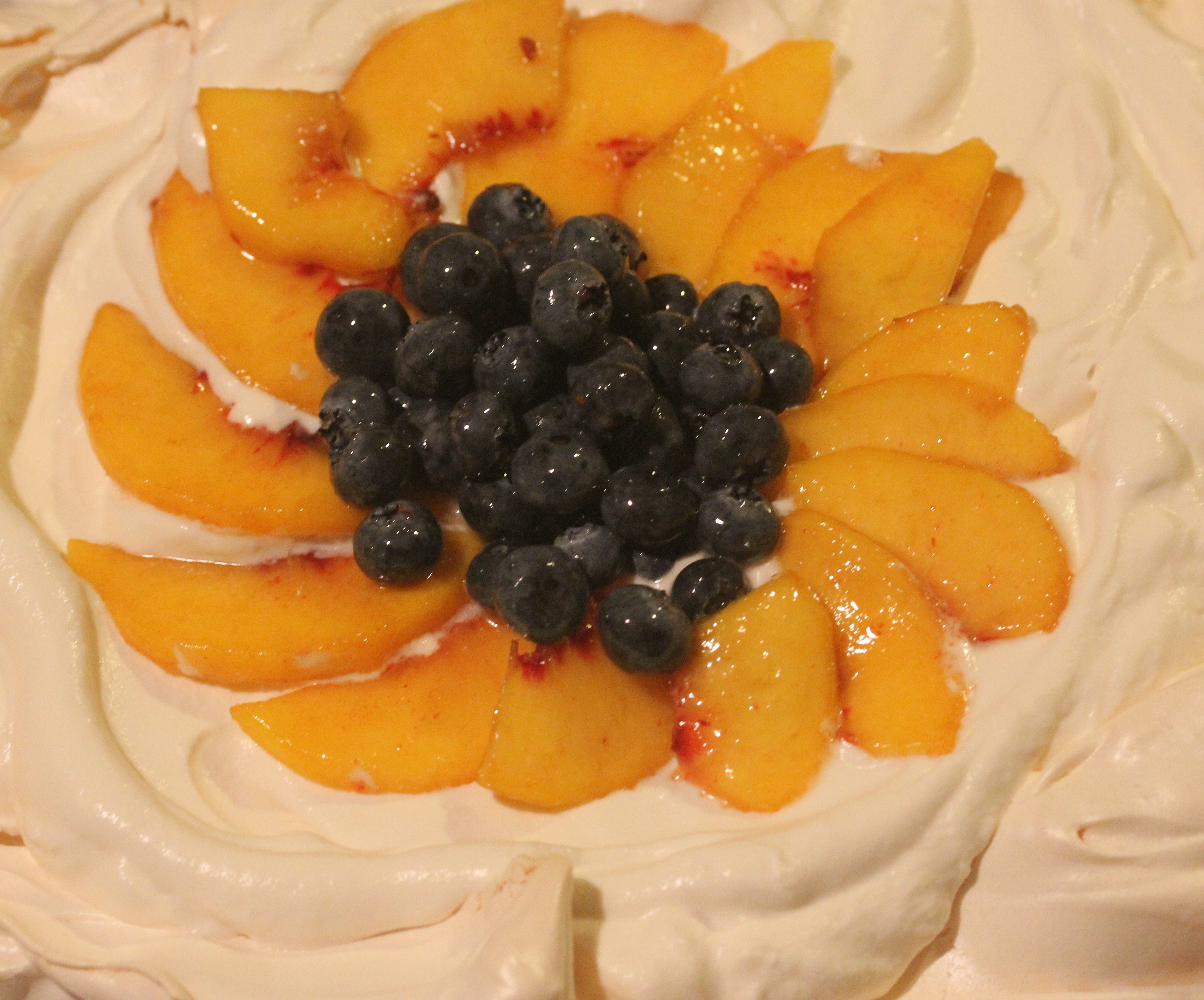 Classic Fruit Pavlova with Blueberries and Peaches or Whatever