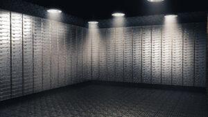 Spotlight on multiple stacked safe deposit boxes
