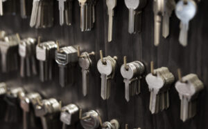 A variety of silver keys hanging on hooks