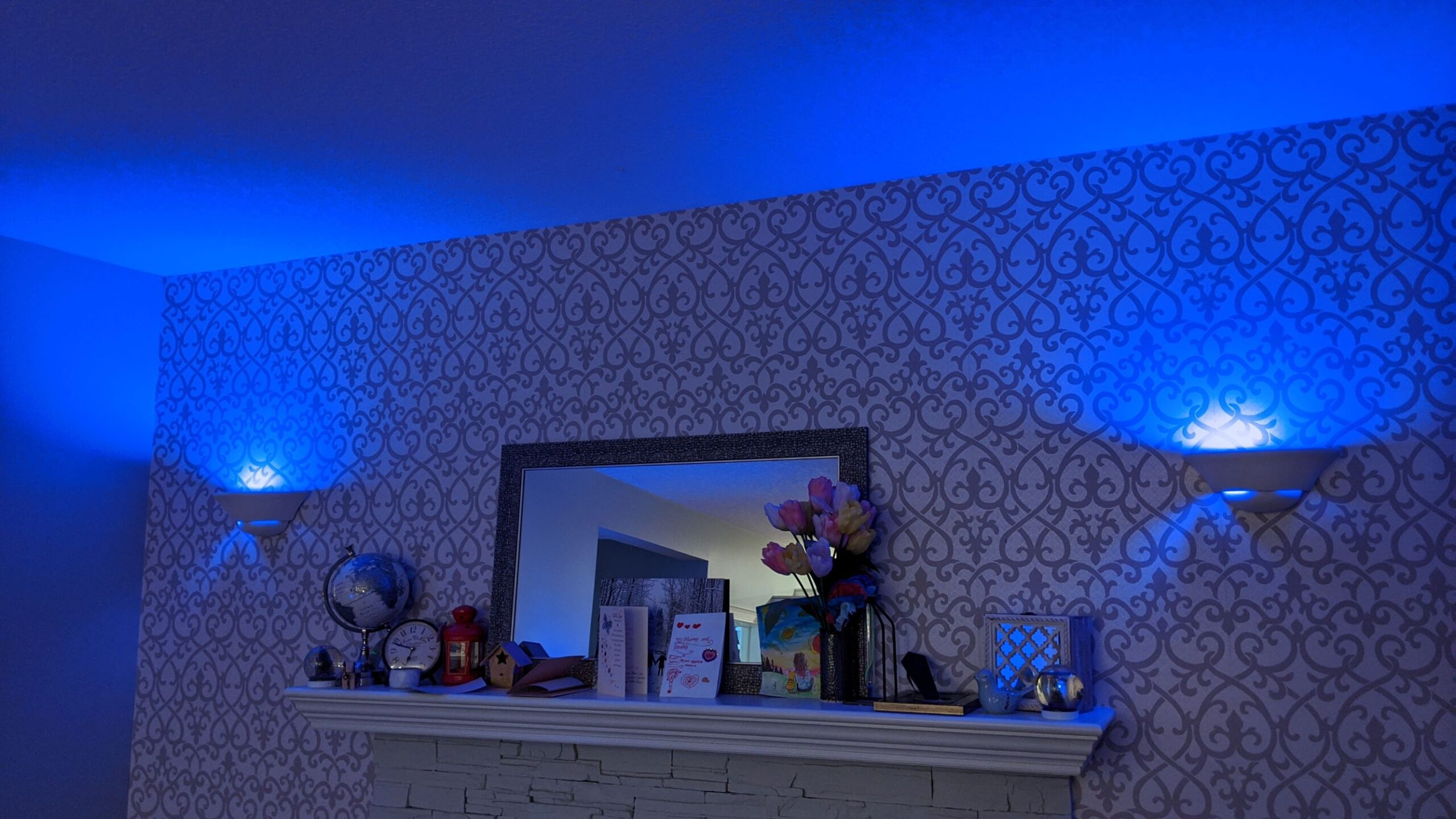 Picture of mantle with matching lights on opposing sides