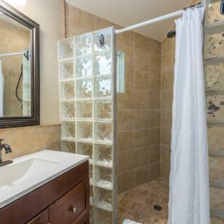 My Roundette bathroom shower has river rock flooring.