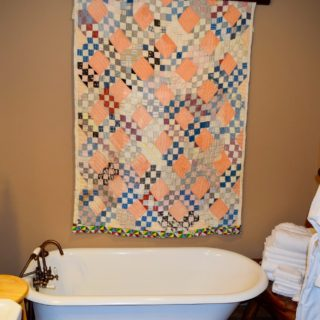 The Huntley Basement Bathroom features a Clawfoot Tub - The Cove at Fairview Vacation Rentals - Asheville NC