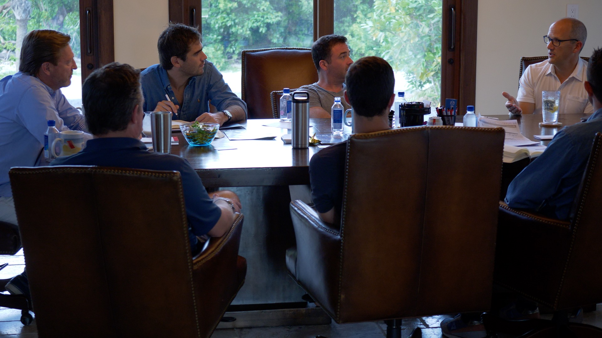 Photo of a Retreat in Marathon with CEOs having a meeting at a conference table