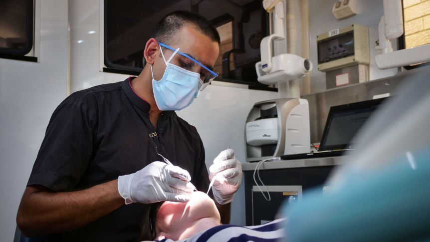 Dental care requires federally funded universal system, health experts say