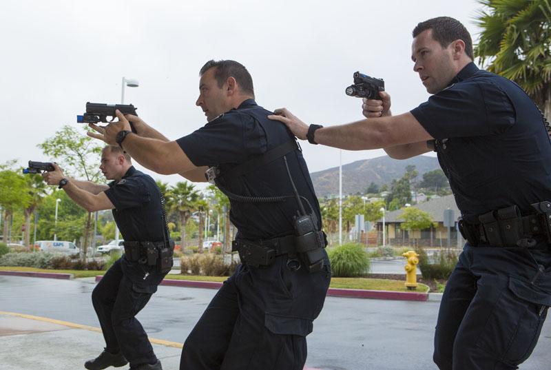 Police respond to the mock shooting.