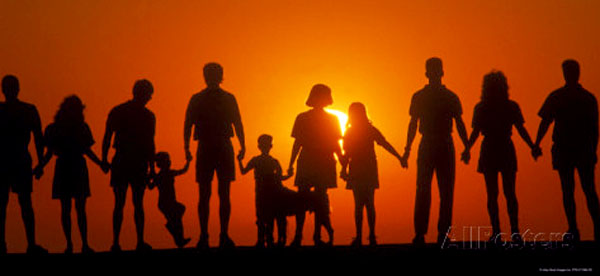 large-family-silhouetted-at-sunset