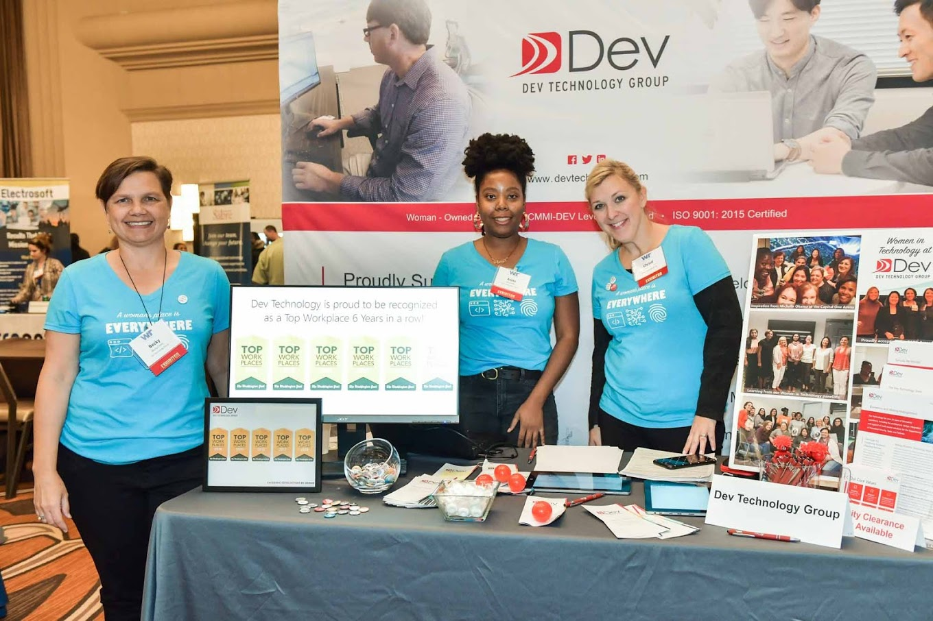 Image of team members at the Women in Technology Career Fair.