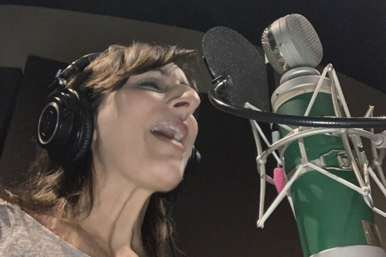 Singer and voiceover talent, Melissa Barber, in the recording studio.