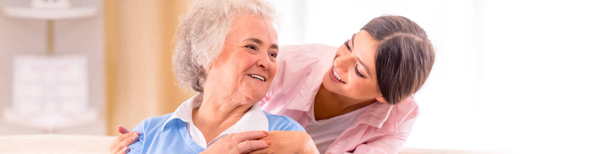 happy senior woman and caregiver