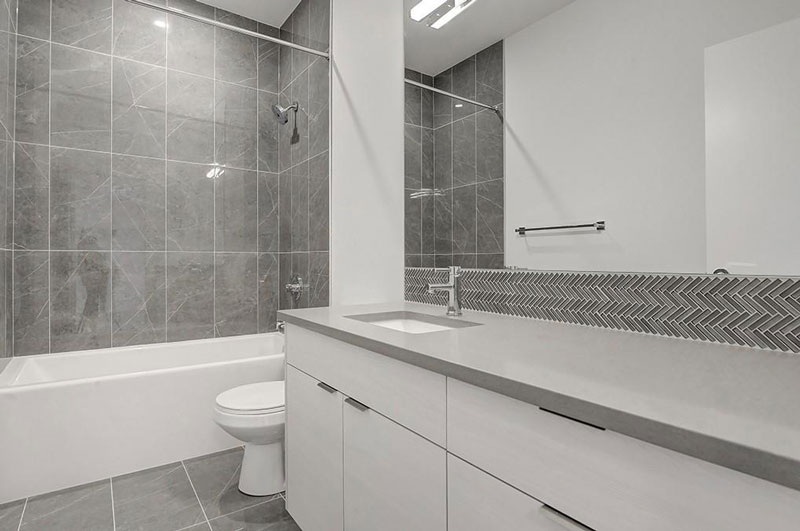 newly renovated bathroom for townhome unit by red tree projects