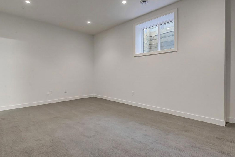 townhome basement renovation with installed carpets