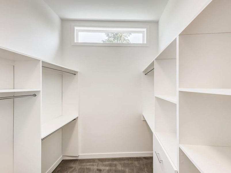 Luxury walk in closet design by Red Tree Projects