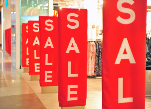 sale signs in a store window