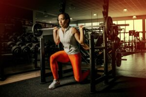 girl with heavy weights squating