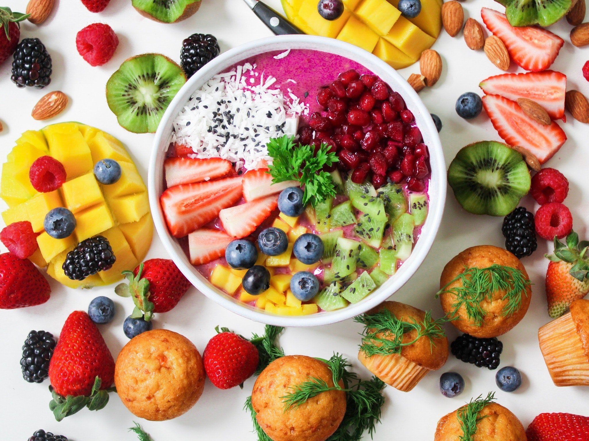 photo of bright colored food, fruit and veggies.