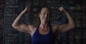fit woman flexing - life changing event