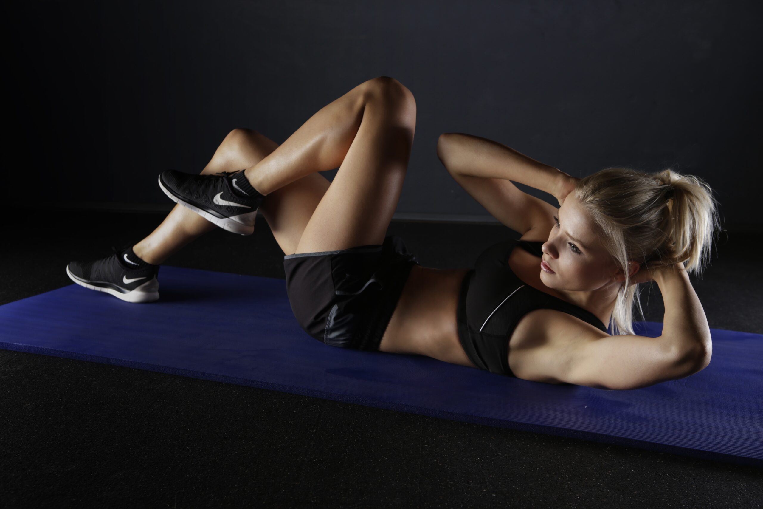 woman on the floor exercising