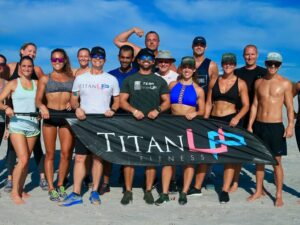 group of titanup fitness members holding up titanup fitness banner