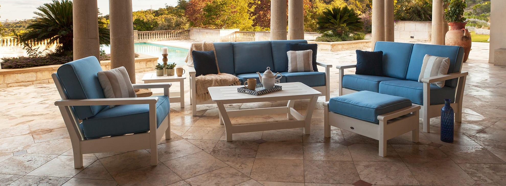 View of blue outdoor furniture on a patio.