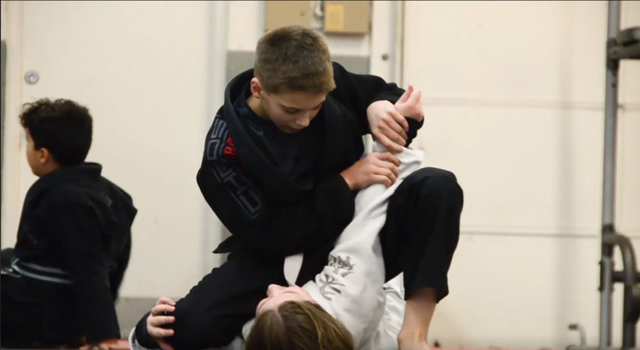 Kids Jiu Jitsu - Practicing an arm bar