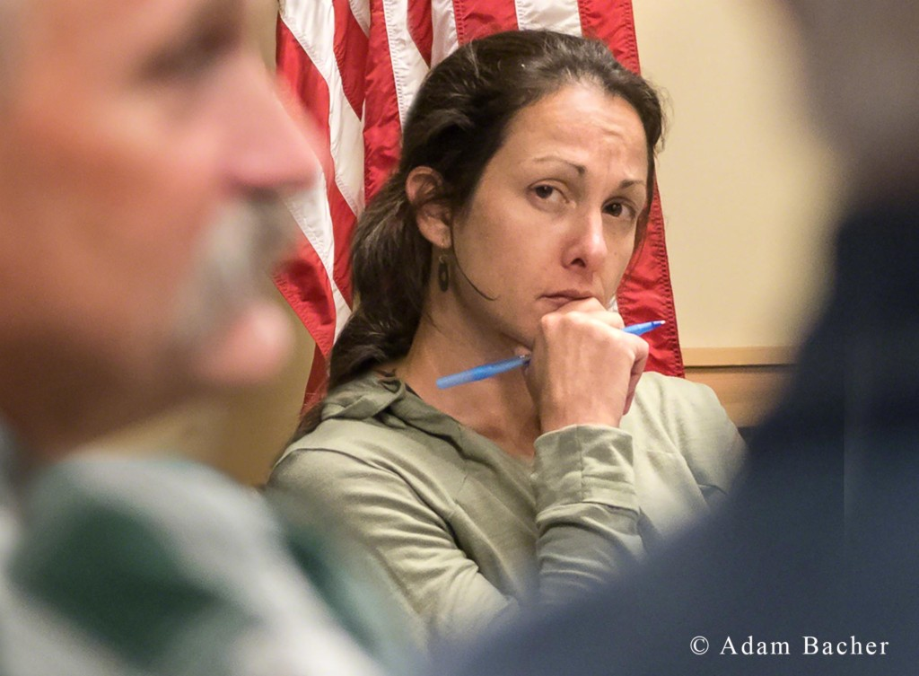 business woman listening to Paul Hessburg, forest fire mega fire presentation