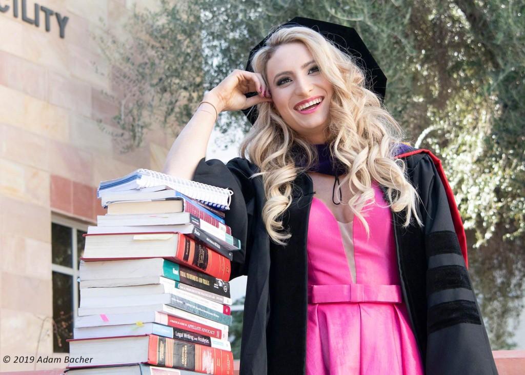 unlv law school graduate with books