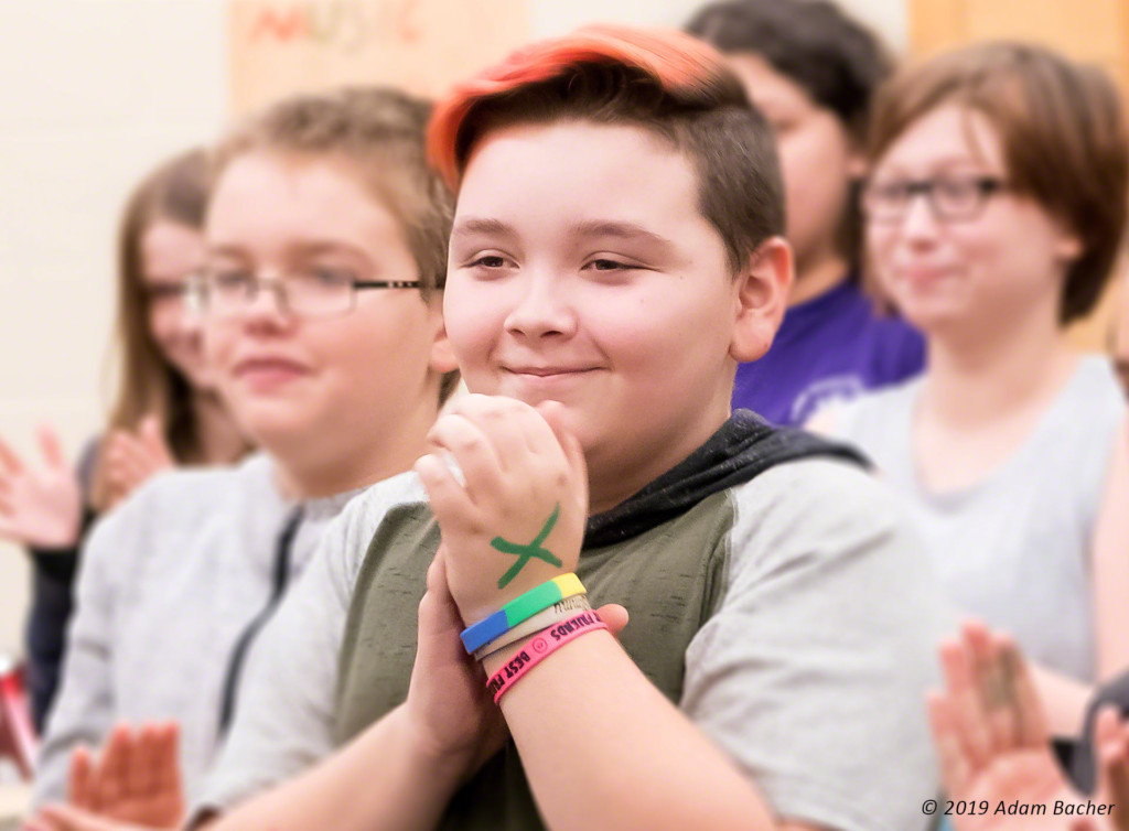 boy with hands clasped, education photography