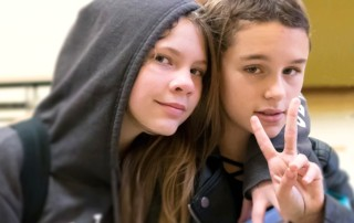 girls making peace sign, editorial photogarphy